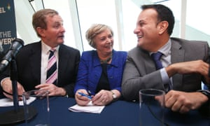 Ireland's Taoiseach and Fine Gael leader Enda Kenny (left) with Minster for Justice Frances Fitzgerald and Minister for Health Leo Varadkar following his party's final press conference on February 24.