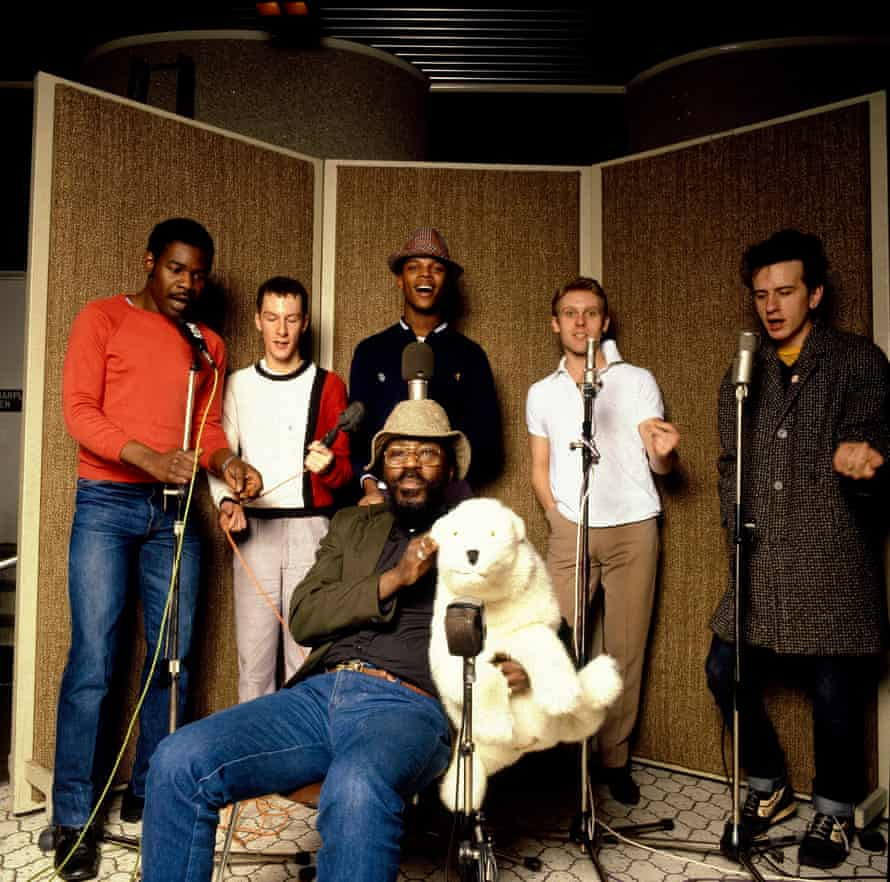 The Beat including Everett Morton (left), Saxa (with fluffy toy) and Ranking Roger (wearing hat).