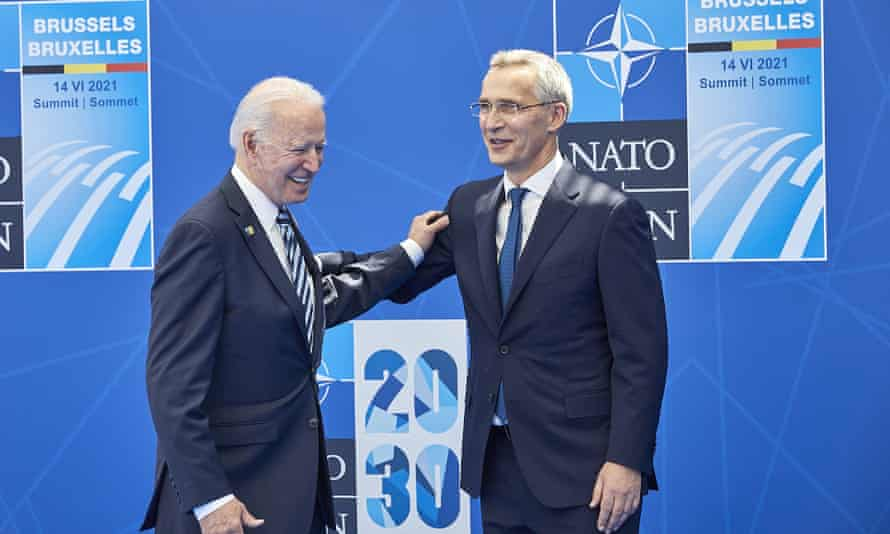 President Biden greets Nato's secretary general, Jens Stoltenberg, at the Nato summit in Brussels on Monday.