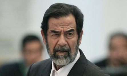Hussein glares at prosecutors as he speaks at his trial in December 2005.