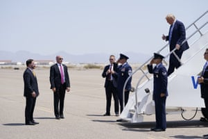 Arizona Governor Doug Ducey, left, waits as President Donald Trump exits Air Force One in Yuma, Arizona.