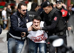 Istanbul, Turkey Riot police arrest a protester who tried to reach Taksim Square for a May Day celebration. Officers imposed tight security measures around the area after the interior ministry denied permits for a gathering