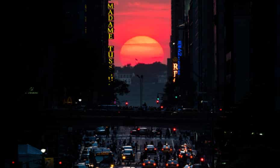 A Manhattanhenge sunset. Manhattanhenge happens when the rising or setting sun aligns with the street grid in the New York City borough.
