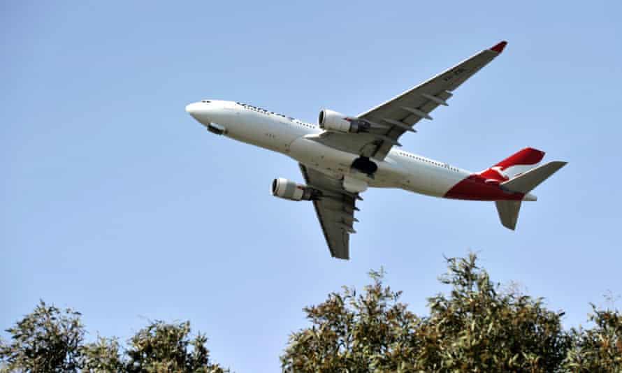 A Qantas plane over Sydney airport