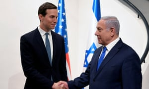 The Israeli prime minister, Benjamin Netanyahu, shakes hands with Jared Kushner during their meeting in Jerusalem, 30 May 2019.