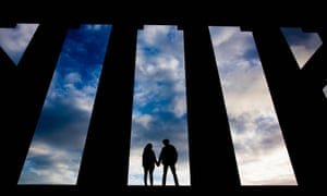 Silhouetted couple holding hands