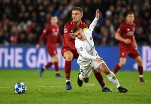 Jordan Henderson of Liverpool collides with PSG's Marco Verratti.