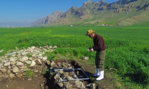 Halkawt Qadr, a Kurdish archaeologist, drawing with a planning frame at the site of Qalatga Darband