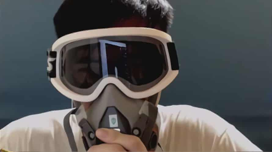 """Screencap from the Hearthstone stream where Chung """"Blitzchung"""" Ng Wai made pro-Hong Kong statements, donning a gas mask and goggles"""