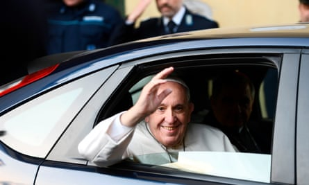 Pope Francis leaves the Regina Coeli prison in Rome after washing the feet of inmates.
