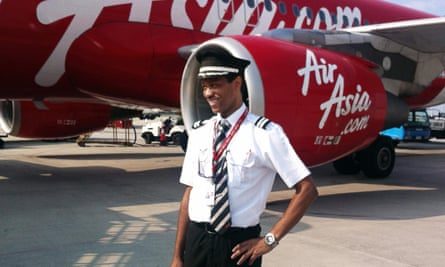 Co-pilot of the ill-fated Malaysian air carrier AirAsia flight QZ8501, Remi Emmanuel Plesel, poses in front of an Air Asia aircraft at an unknown location. The French co-pilot was at the controls of the AirAsia plane before it crashed into the sea.