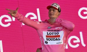 André Greipel puts on the race leader's maglia rosa – or pink jersey – after winning the Giro d'Italia's second stage in Sardinia.