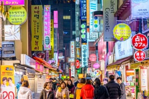 Crowds enjoy the Myeong-Dong district nightlife in Seoul.