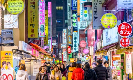 crowds in the Myeong-Dong district of Seoul.