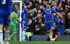 Cesc Fabregas celebrates scoring the third goal with Diego Costa.