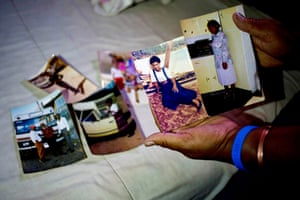 Matwsie Serati is HIV positive and taking antiretroviral drugs. She is pictured with photographs of several brothers and sisters who have died
