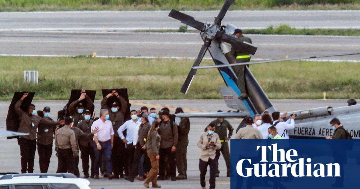 Helicopter carrying Colombian president and senior officials hit by gunfire