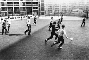 The people bring these images to life ... boys play football on the Park Hill Estate in 1961.
