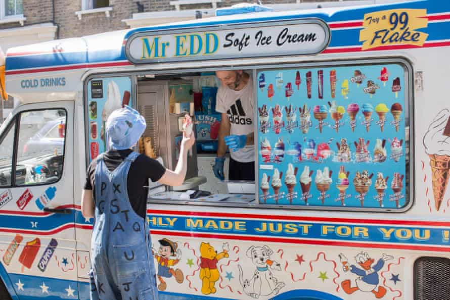 A customer at an ice-cream van at Victoria park, east London.