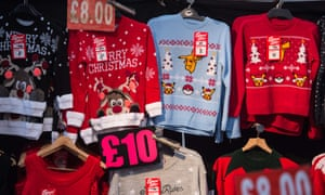 Christmas-themed jumpers  for sale on a market stall