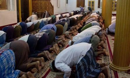 Muslim men praying at a mosque in Yangon, Myanmar
