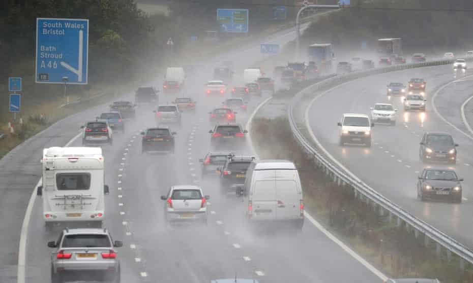 Cars driving in rain on motorway.