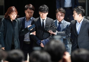 Seoul, South Korea Singer-songwriter Lee Seung-hyun (centre), also known by his stage name, Seungri, addresses the media while waiting for the result of his hearing at the District Court. The 28-year-old singer from popular boy band BIGBANG and his business partner are accused of arranging sex services for potential investors and rich clients at a nightclub owned by the pair