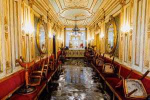 The clear up begins in the historic Florian cafe in San Marco square as flood water start to subside
