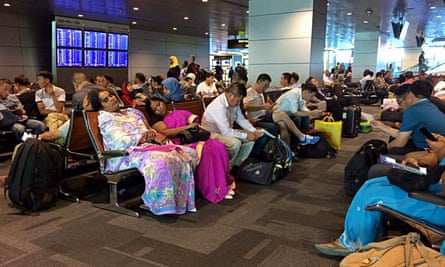 Passengers of cancelled flights wait in Hamad international airport in Doha, Qatar.