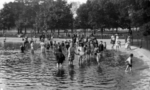 A crowd of people take to the water of the Serpentine in Hyde Park to cool off, during the heatwave of 1911.