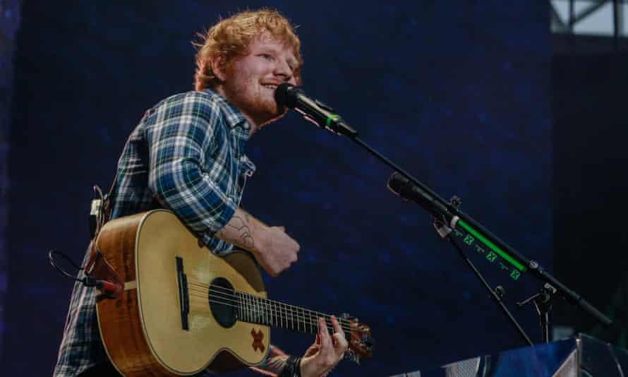 Ed Sheeran performing at Wembley Stadium.