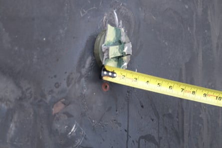 A handout photo made available by the US Department of Defense (DoD) shows the aluminum and green composite material left behind following removal of an unexploded limpet mine used in an attack on the starboard side of motor vessel M/T Kokuka Courageous.