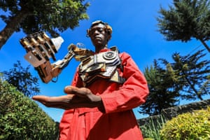 Kikuyu, Kenya: David Gathu, a self-taught innovator, demonstrates a recently invented robotic arm at a workshop north of Nairobi
