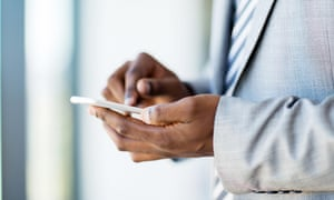 close up of businessman hands texting on smart phone