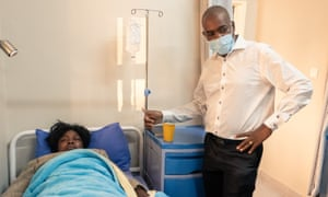 Cecilia Chimbiri on a hospital bed alongside her MDC party leader, Nelson Chamisa.
