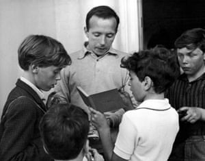 Stiles signs autographs for young fans outside the England team's hotel in Hendon on 23 July 1966