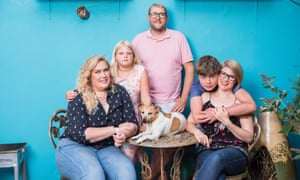 Lucy Frederick (far left), with her partner, James, his ex-wife, Emily, their children and Heston the dog