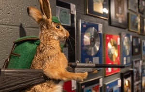 Flint's gold and platinum selling albums alongside a stuffed hare