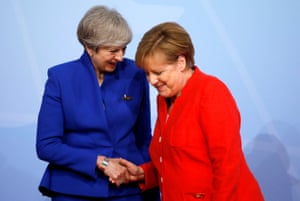 Merkel welcomes Theresa May.