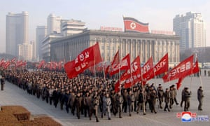 North Korean government officers depart for a labor workday at a farm near Pyongyang.