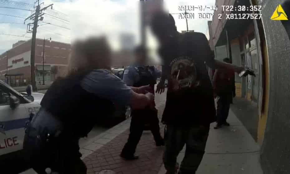 Chicago police attempt to grab Harith Augustus, 37, who fatally shot by police moments later, in this still image from police body camera video footage taken in Chicago, Illinois.