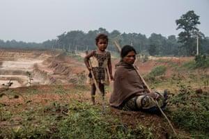 A local family on the edge of the Adani-managed Parsa East and Kanta Basan open cut coal mine, Chhattisgarh.