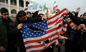Iranians burn a US flag in Tehran on Friday.