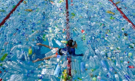 A child swims in a pool filled with plastic bottles during a World Oceans Day awareness campaign in Bangkok.