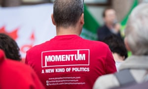 A campaigner wears a Momentum t-shirt at a rally in Cardiff.