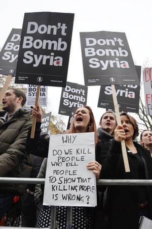 A protester with a homemade sign at Whitehall in London.