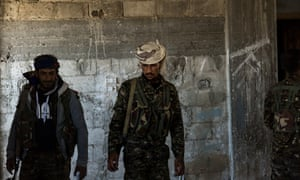 SDF fighters seen inside a building used as a temporary People's Protection Units base