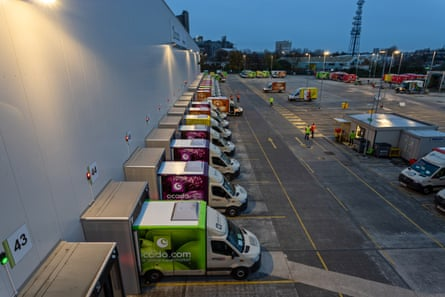 Ocado's distinctive vans are loaded at the warehouse in Erith.