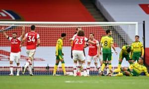 Cedric Soares of Arsenal celebrates with teammate David Luiz after scoring his team's fourth goal.