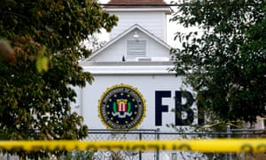 An FBI truck still sits in front of the Sutherland Springs church while investigators work at the scene.